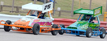 Stock cars racing side-by-side
